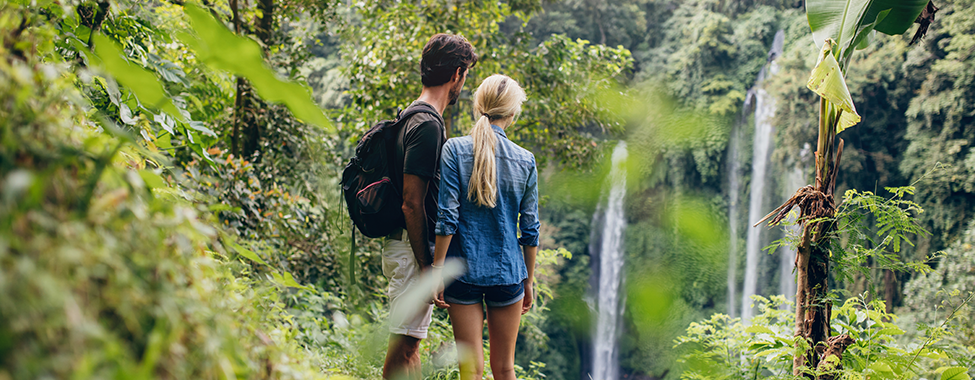 Couple-Exercising-on-Vacation-with-a-Tropical-Hike