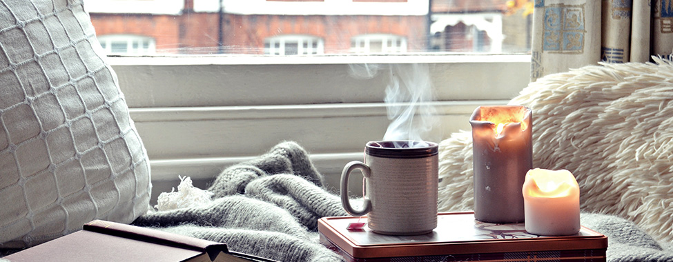 Cozy-Setting-with-Book-and-Candles-for-Spa-Day-at-Home