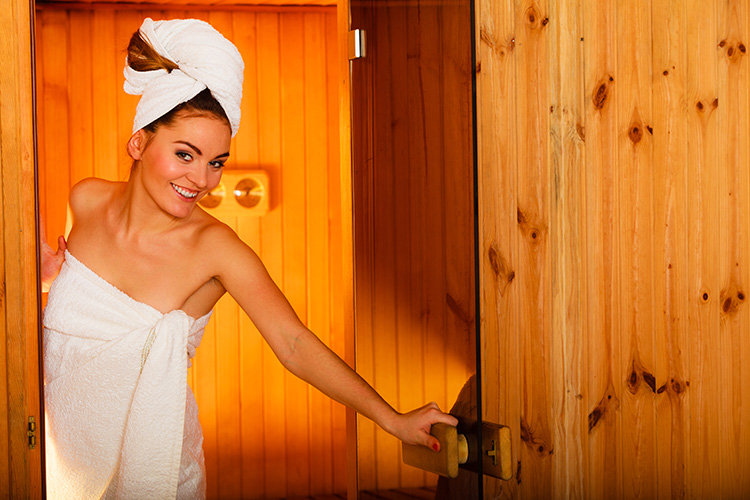 Happy-woman-in-an-infrared-sauna