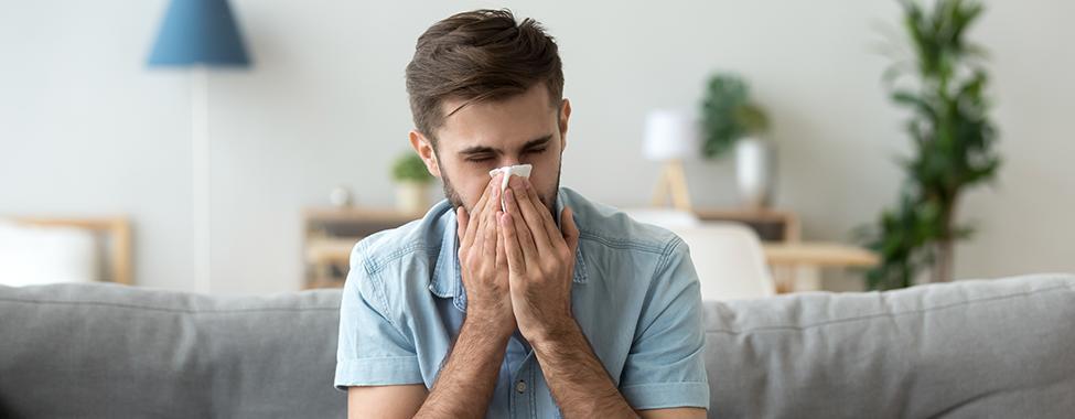 Man-Sneezing-Due-to-Sickness