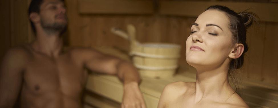 Man-and-Woman-Using-Sauna-to-Detox-from-Smoking
