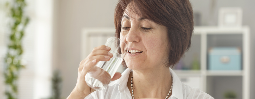 Middle-Aged-Woman-Drinking-Water-During-Menopause