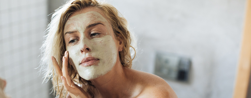 Woman-Applying-Face-Mask-for-Skin-Care-Routine