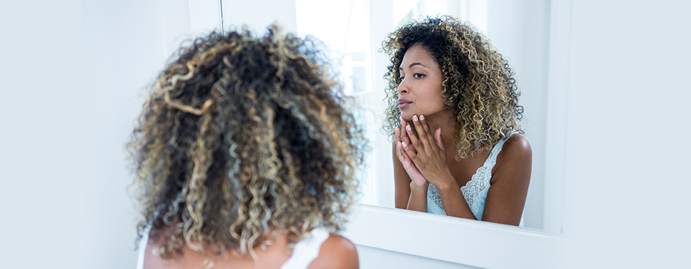 Woman Admiring Clear Skin from Infrared Sauna Use