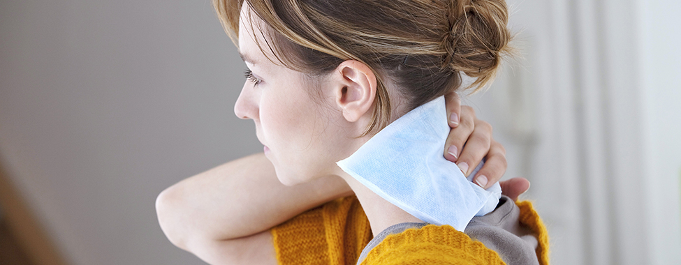 Woman-Doing-Direct-Contact-Heat-Therapy-with-Heating-Pad