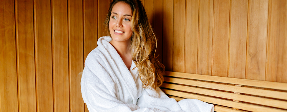 Woman Sitting in Infrared Sauna for Health Benefits