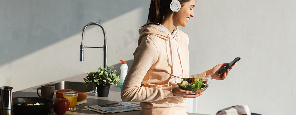 Woman-Laughing-and-Listening-to-Nutrition-Podcasts