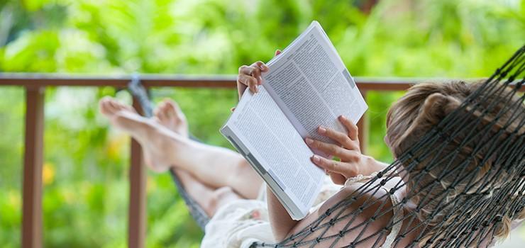 Woman-Reading-Book-on-Hammock