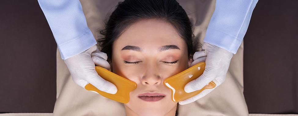 Woman-Receiving-Gua-Sha-Skincare-Treatment
