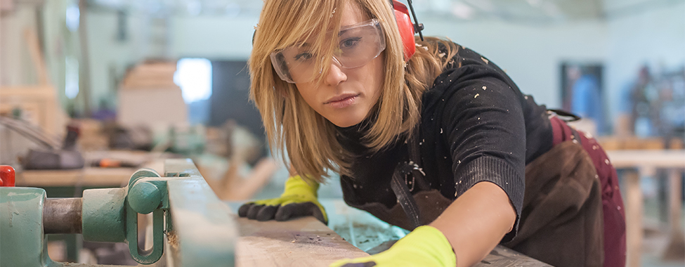 Female carpenter Using Electric Sander / Female carpenter Using