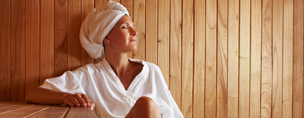 Woman-Sitting-in-Sauna-to-Boost-Immune-System-Naturally