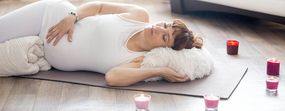 Woman-Using-Candles-for-Aromatherapy-while-Pregnant