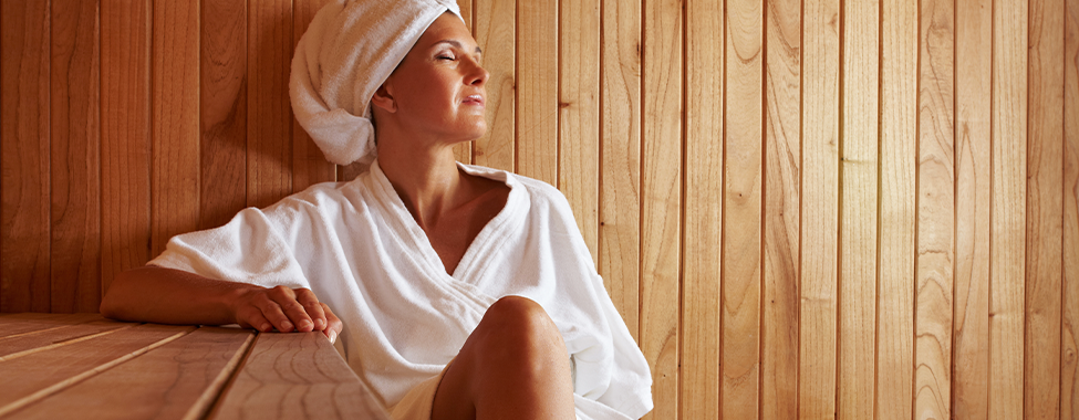 Woman-Using-Infrared-Sauna-to-be-Healthy-at-Home