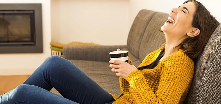Women-Drinking-Tea-On-Couch