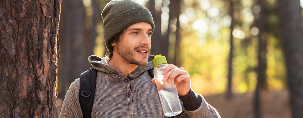 Man Drinking Water to Stay Hydrated in Winter