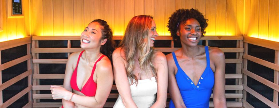 Friends Enjoying Infrared Sauna Health Benefits