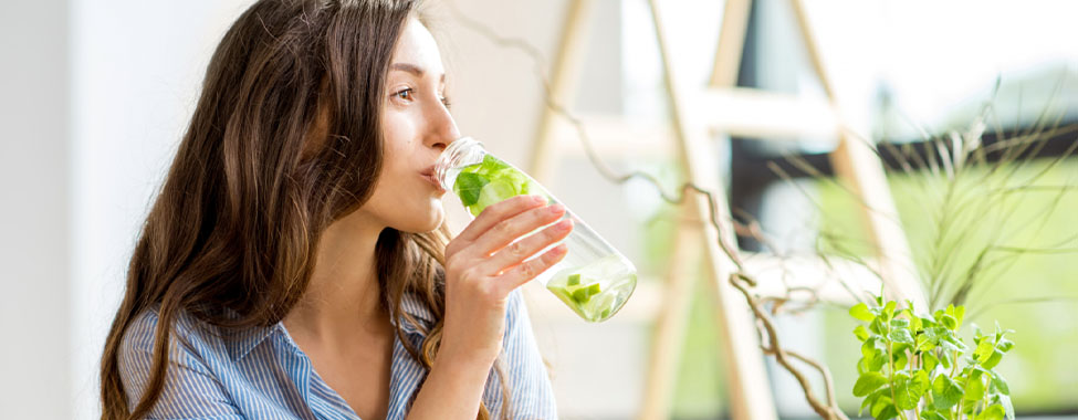 Woman Drinking Water the Hydrate in Hot Weather