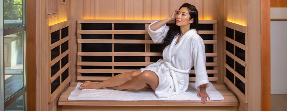 Woman Investing in Health with Clearlight Infrared Sauna