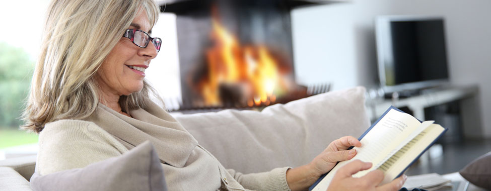 Woman Reading Book to Take Break from Screens
