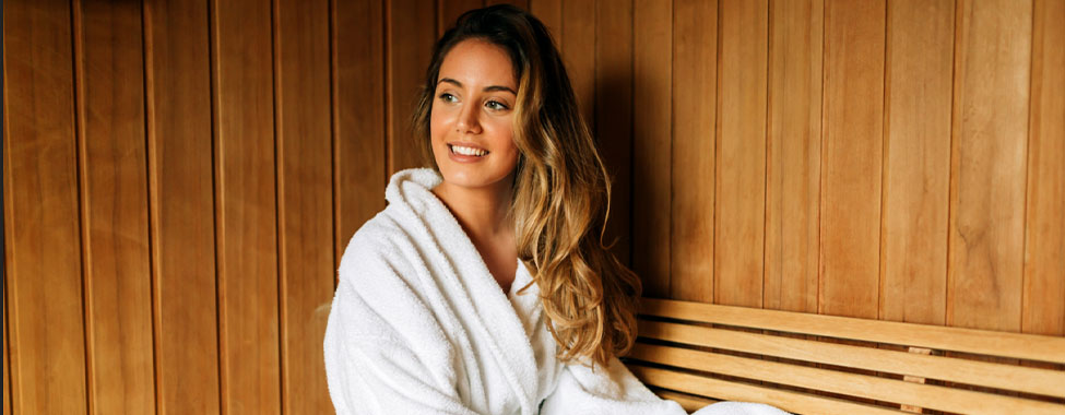 Woman in Infrared Sauna for Overall Health