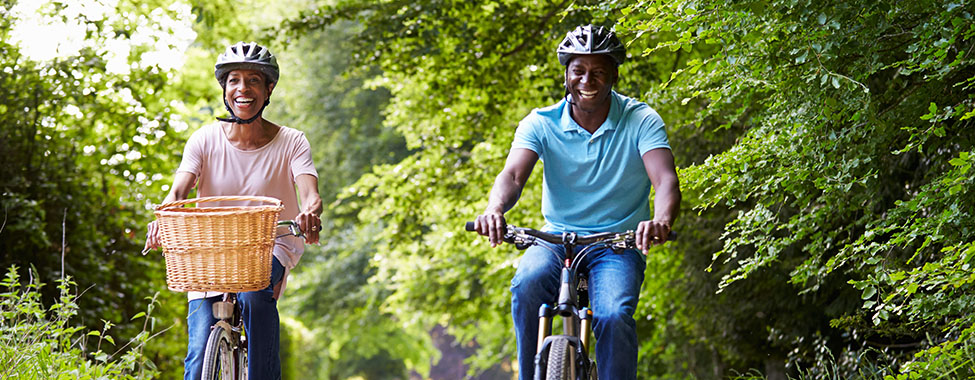Couple Riding Bikes and Exercising Outdoors