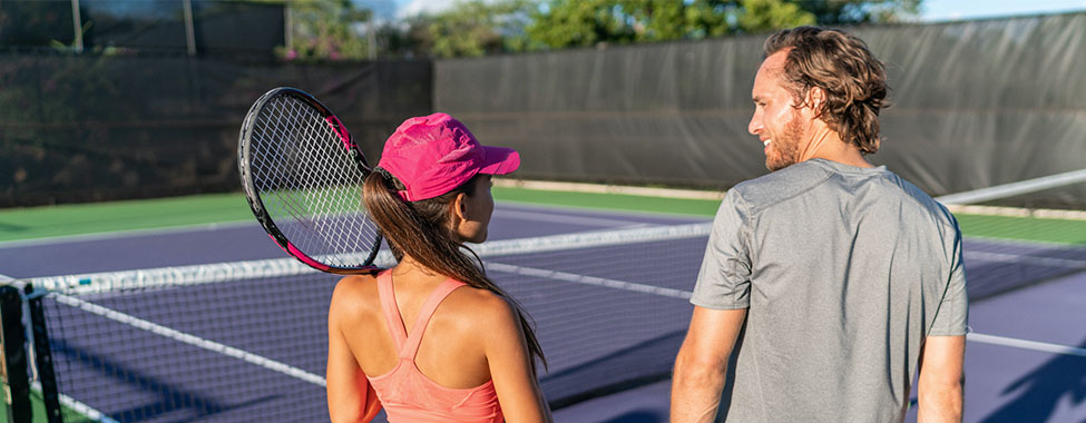 Friends Playing Tennis in Spring for Outdoor Workouts