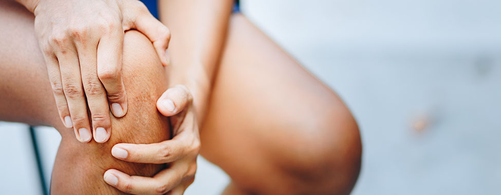 Person with Joint Pain Holding Knee
