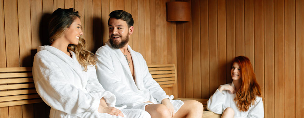 Friends Using Infrared Sauna for HSP Heat Therapy