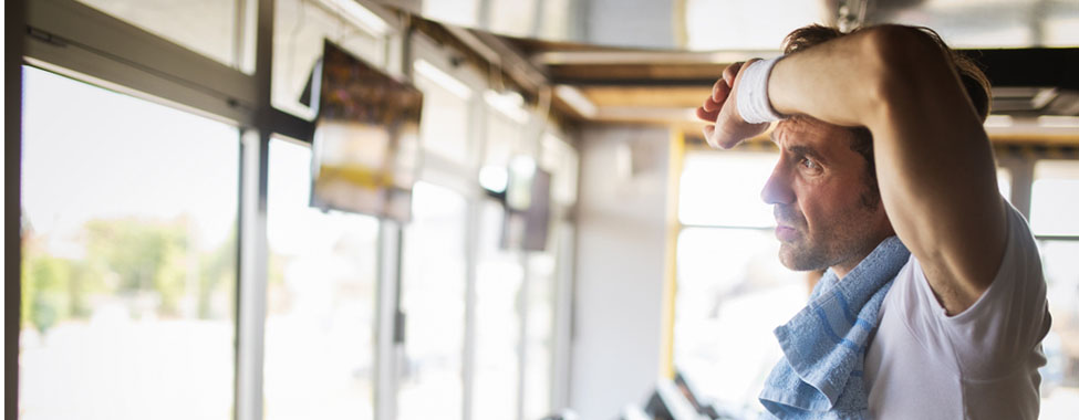 Man Sweating at Gym for Heat Shock Protein Production