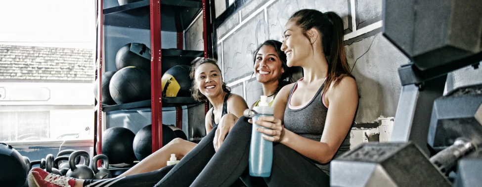 Sweating Friends Smiling After Workout