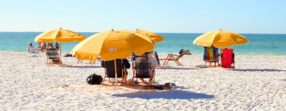 Umbrellas Over Beach Chairs for Shade from Heat